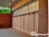 Custom Counterweight Garage Door Clad in 'Carriage Style' with Windows
